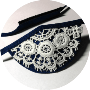 navy blue custom eye patch with off-white flowery lace detail